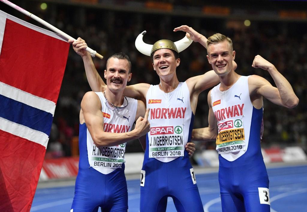 Norway's gold medal winner Jakob Ingebrigtsen is flanked by his brothers Henrik Ingebrigtsen, left, and Filip Ingebrigtsen after the men's 1500-meter