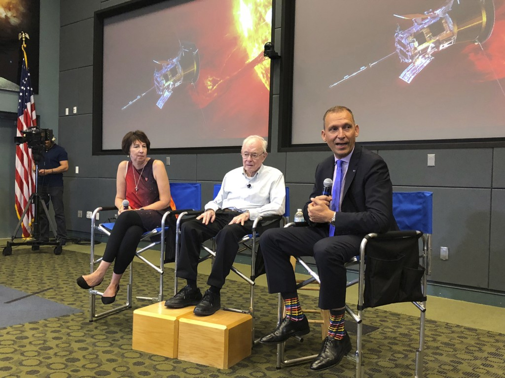 In this Thursday, Aug. 9, 2018 photo, astrophysicist Eugene Parker sits between Johns Hopkins University project scientist Nicola Fox, left, and NASA'