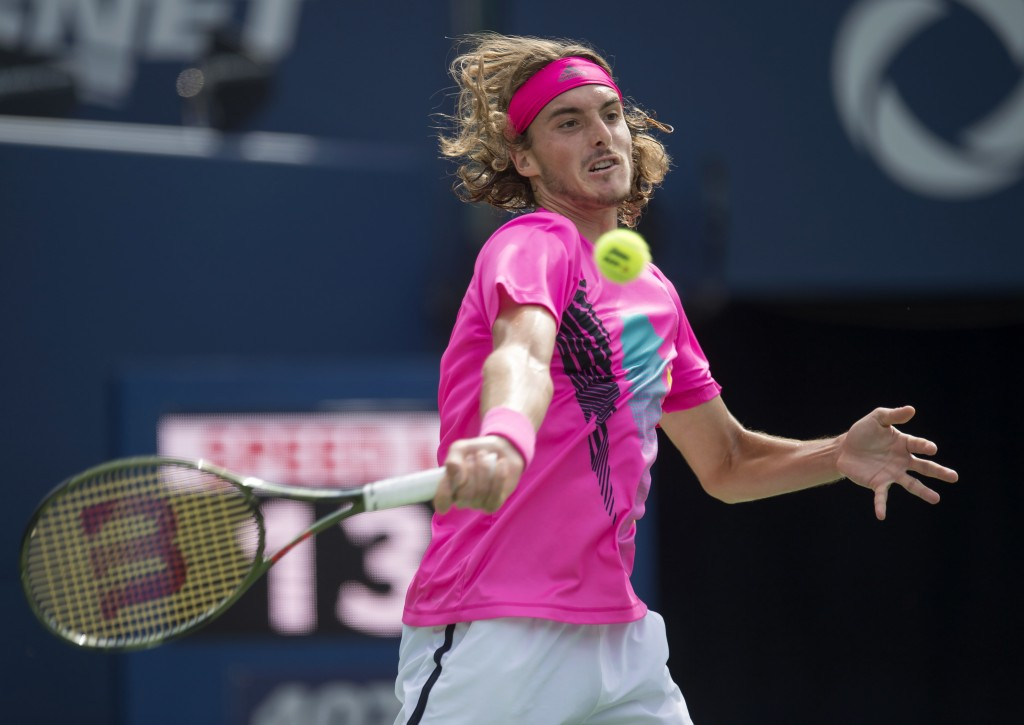 Stefanos Tsitsipas of Greece hits a forehand to Alexander Zverev of Germany during Rogers Cup quarterfinal tennis tournament action in Toronto on Frid