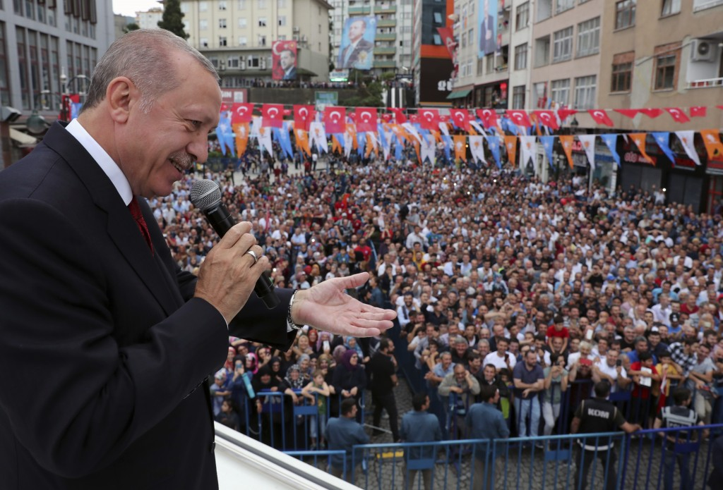 Turkey's President Recep Tayyip Erdogan addresses his supporters in his Black Sea hometown, Rize, Turkey, Saturday, Aug. 11, 2018.(Presidential Press