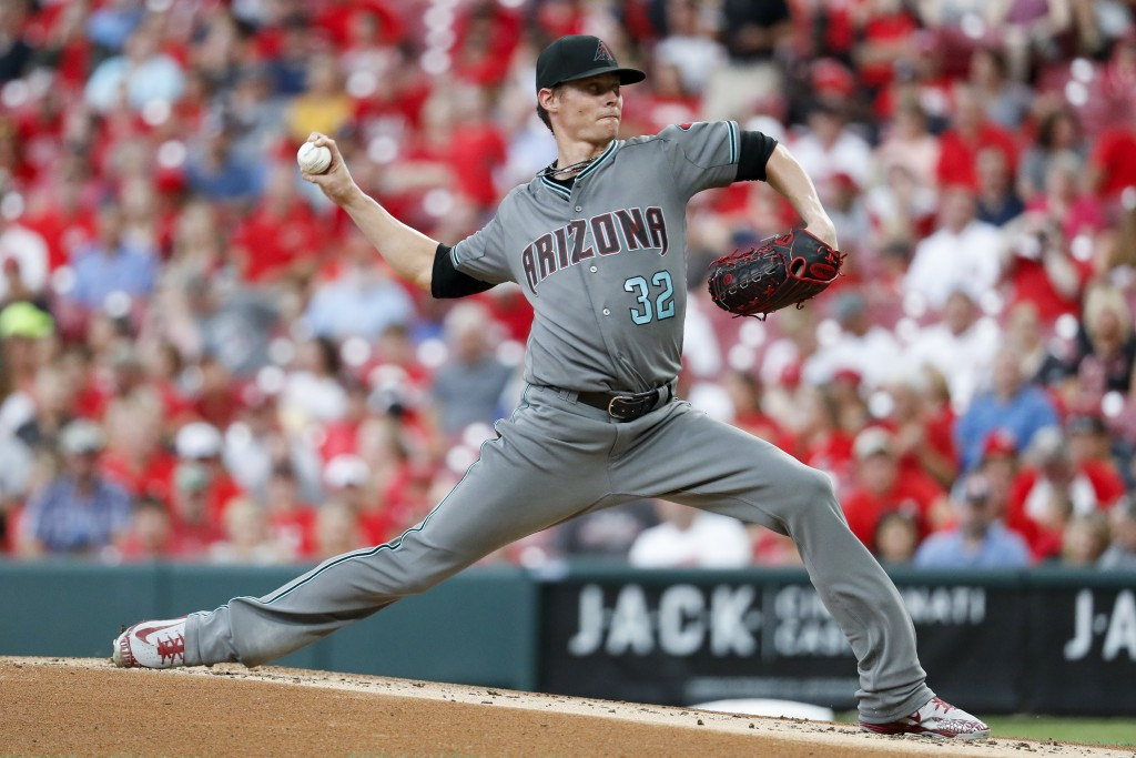 Arizona Diamondbacks starting pitcher Clay Buchholz throws during the first inning of the team's baseball game against the Cincinnati Reds, Friday, Au