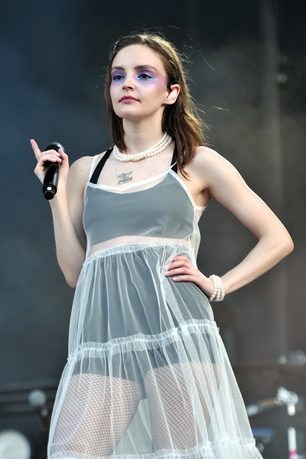 FILE - In this Aug. 2, 2018 file photo, Lauren Mayberry of the band Chvrches performs at Lollapalooza in Chicago. Fans and artists are asking the live