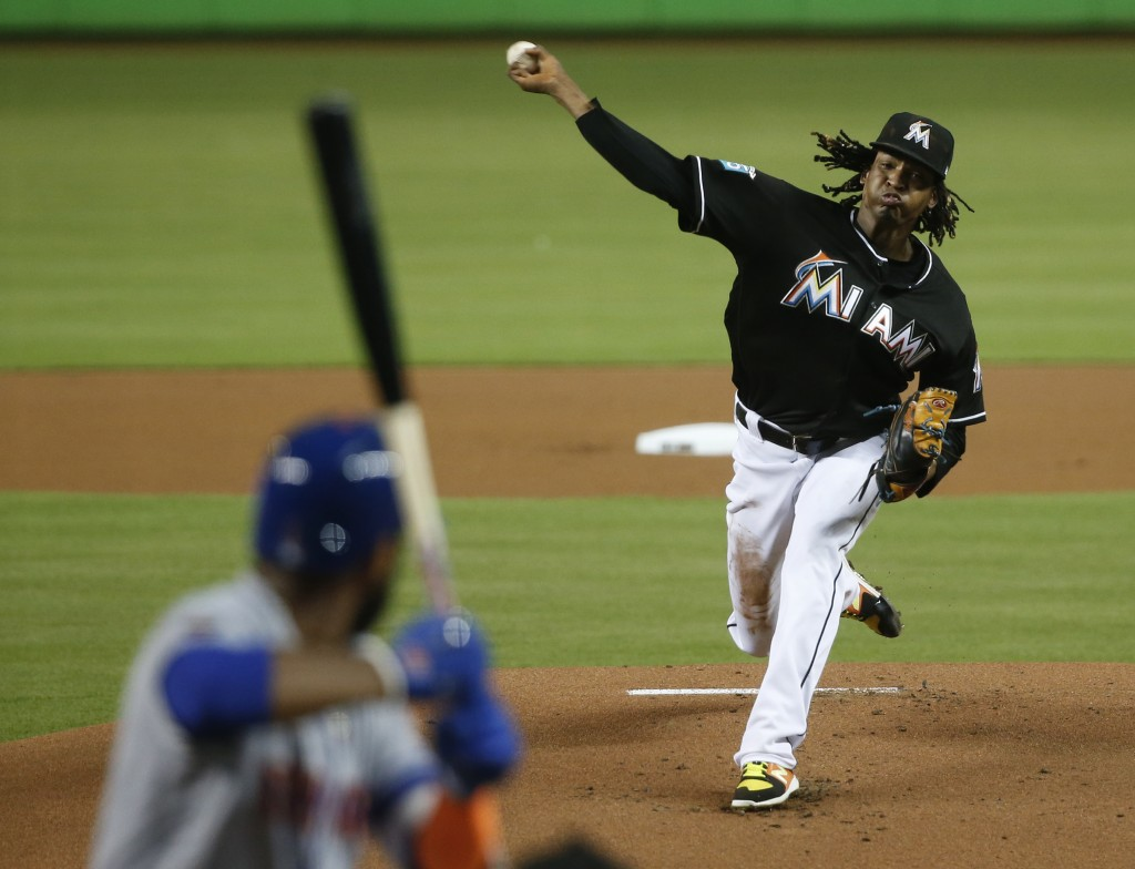 Miami Marlins' Jose Urena pitches to New York Mets' Amed Rosario during the first inning of a baseball game, Friday, Aug. 10, 2018, in Miami. (AP Phot