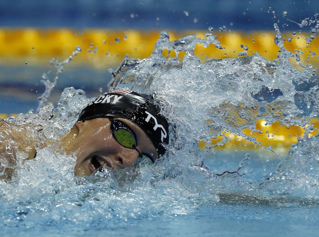 In this Saturday, Aug. 11, 2018, photo, U.S. swimmer Katie Ledecky swims in the women's 400m freestyle final during the Pan Pacific swimming champions...