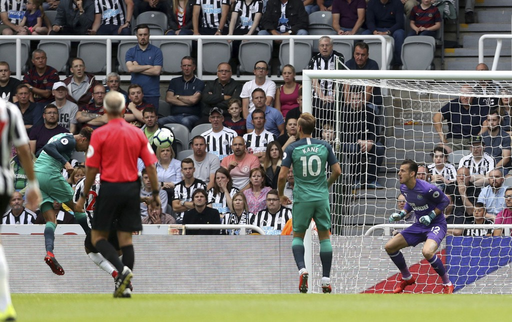 Tottenham's Dele Alli, left, scores his side's second goal of the game against Newcastle during their English Premier League soccer match at St James'