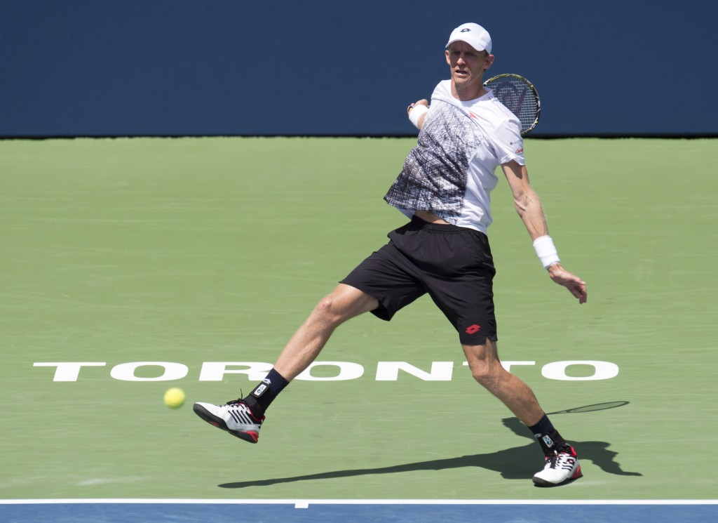 Kevin Anderson of South Africa gets knocked off balance by a serve on his way to defeating Grigor Dimitrov of Bulgaria during Rogers Cup quarterfinal