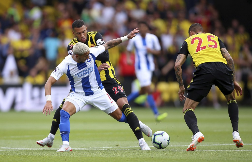 Brighton & Hove Albion's Anthony Knockaert, front, battles with Watford's Etienne Capoue and Jose Holebas, right, during their English Premier League