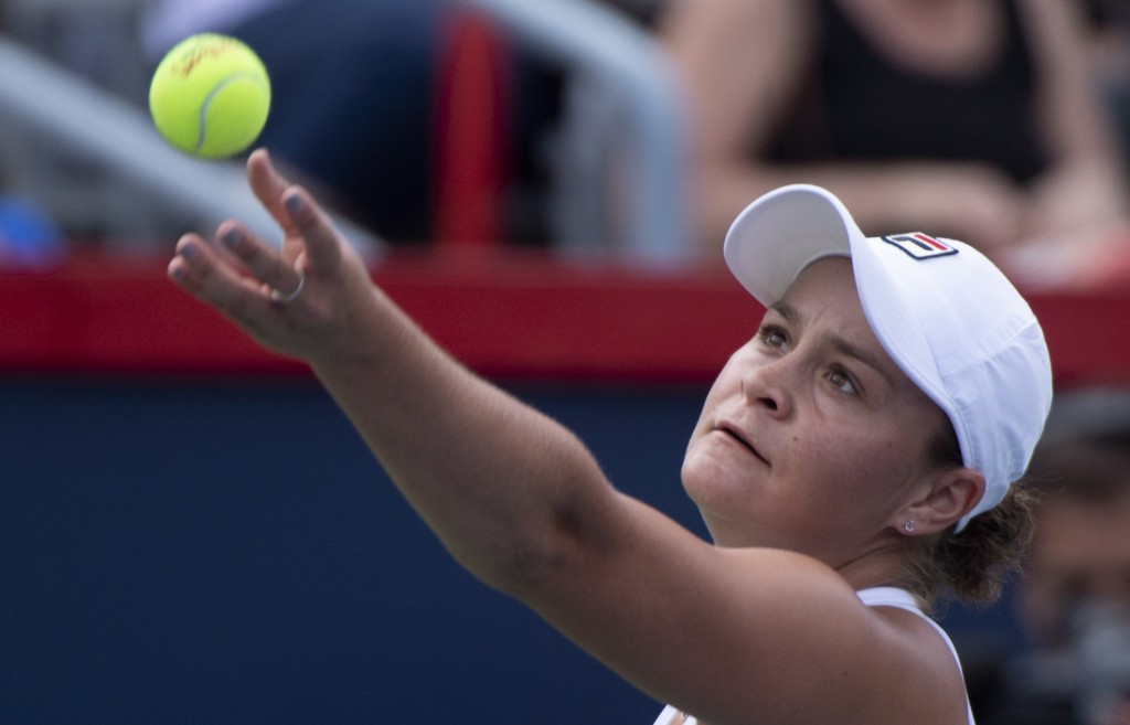 Ashleigh Barty of Australia tosses the ball to serve to Kiki Bertens of the Netherlands during quarter-finals play at the Rogers Cup tennis tournament