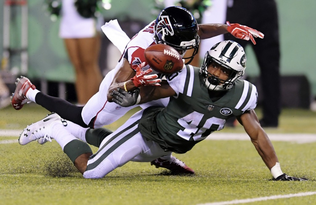 Atlanta Falcons wide receiver Reggie Davis defends against New York Jets' Trenton Cannon (40) during the second half of a preseason NFL football game