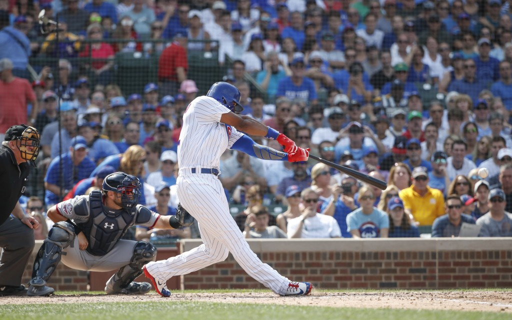 Chicago Cubs' Jason Heyward hits two-run single off of Washington Nationals' Sammy Solis during the sixth inning of a baseball game, Friday, Aug. 10,