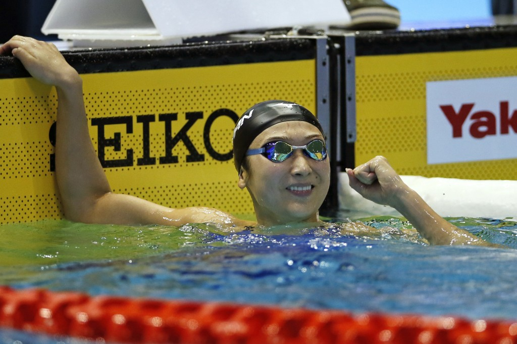 Japan's Rikako Ikee reacts after winning the women's 100m butterfly final during the Pan Pacific swimming championships in Tokyo, Saturday, Aug. 11, 2