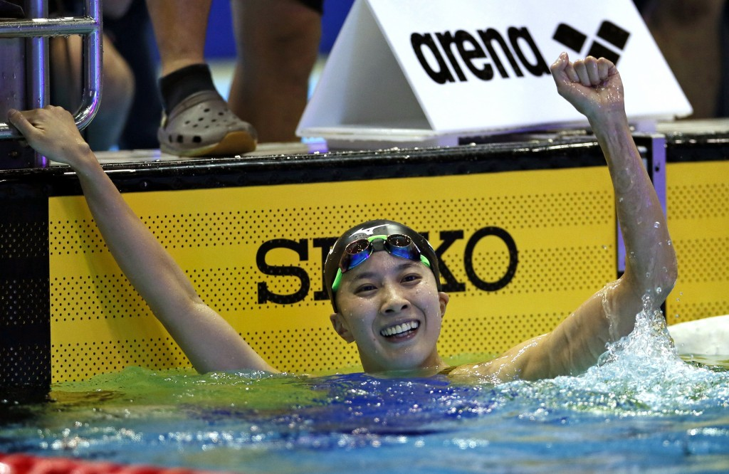 Japan's Yui Ohashi celebrates after winning the women's 200m individual medley final during the Pan Pacific swimming championships in Tokyo, Saturday,