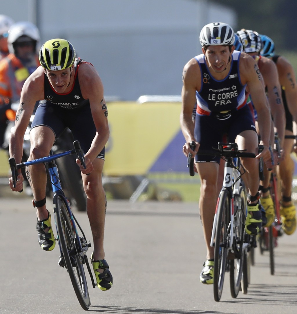Alistair Brownlee of Great Britain, left, and Pierre Le Corre of France, right, participate in the cycling discipline of the men's triathlon finals at...