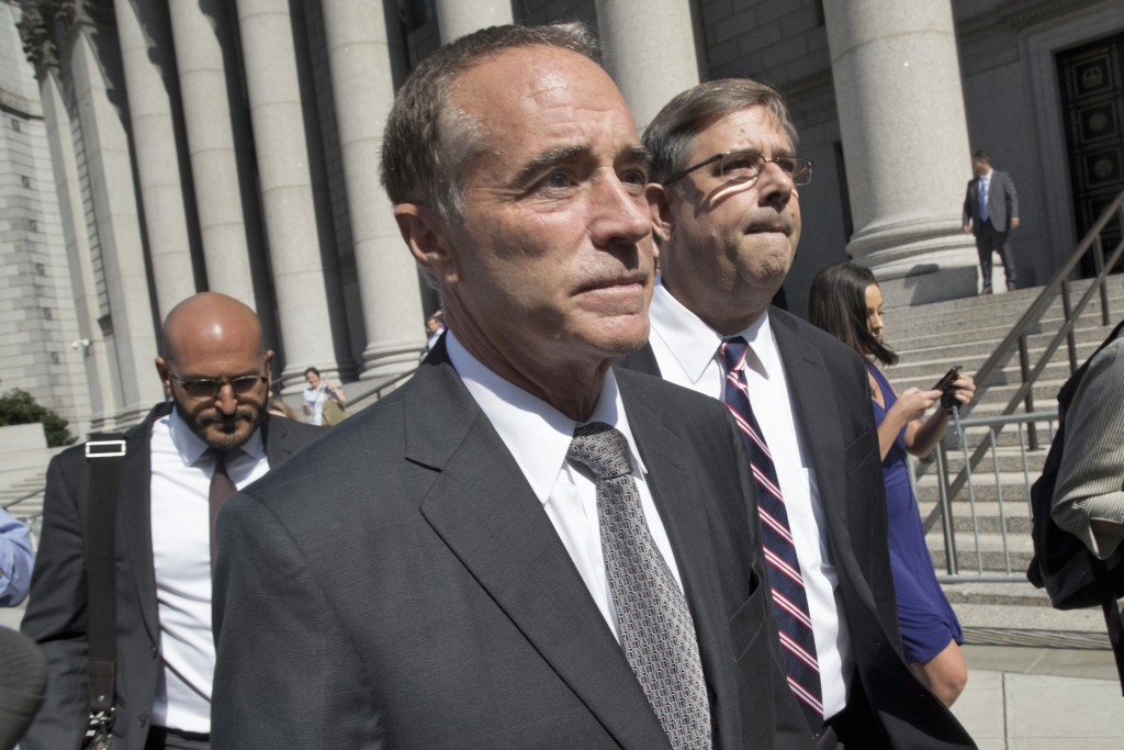 FILE - This Aug. 8, 2018 file photo shows Republican U.S. Rep. Christopher Collins as he leaves federal court in New York. In an about-face, Collins s