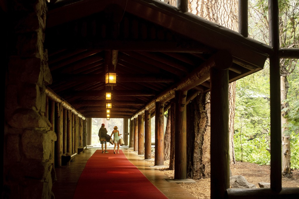 FILE - In this July 25, 2018 file photo, guests leave the The Majestic Yosemite Hotel, formerly The Ahwahnee Hotel, shortly after it closed in Yosemi...