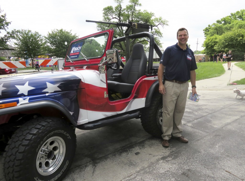 FILE - This June 2, 2018, file photo provided by the Kobach for Governor campaign shows Kansas Secretary of State Kris Kobach posing next to a Jeep mo...