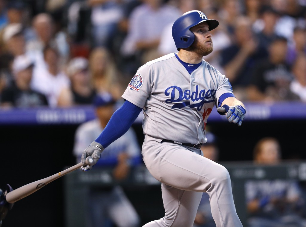 Los Angeles Dodgers' Max Muncy watches his two-run home run off Colorado Rockies starting pitcher Jon Gray during the fourth inning of a baseball game