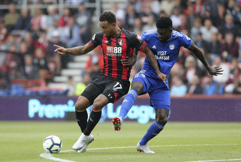 Bournemouth's Joshua King, left, and Cardiff City's Bruno Ecuele Manga in action during their English Premier League soccer match at the Vitality Stad