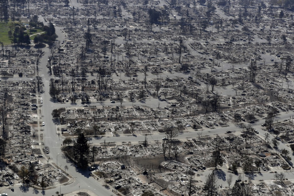 FILE - In this Oct. 14, 2017, file photo, an aerial view shows the devastation of the Coffey Park neighborhood after a wildfire swept through in Santa