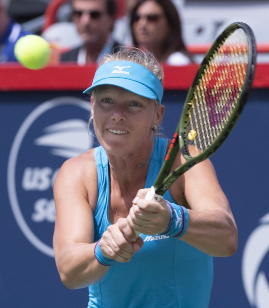 Kiki Bertens of the Netherlands returns to Ashleigh Barty of Australia during quarter-finals play at the Rogers Cup tennis tournament Friday, Aug. 10,
