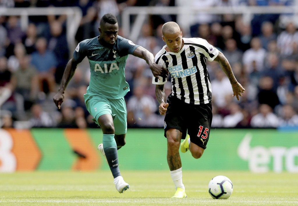 Newcastle United's Kenedy, right, and Tottenham Hotspur's Davinson Sanchez run for the ball during their English Premier League soccer match at St Jam...