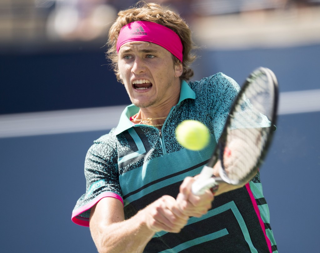 Alexander Zverev of Germany hits a backhand to Stefanos Tsitsipas of Greece in Rogers Cup quarterfinal tennis tournament action in Toronto onFriday, A