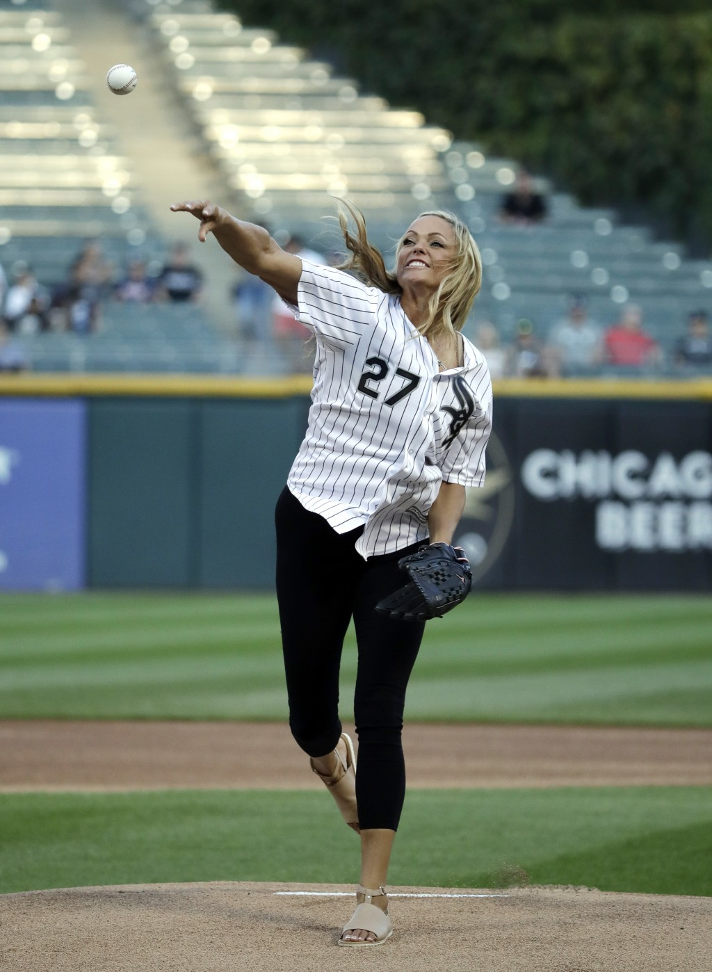 Jennie Finch, a former Arizona college softball All-American and a U.S. Olympian, throws out the ceremonial first pitch prior to a baseball game betwe