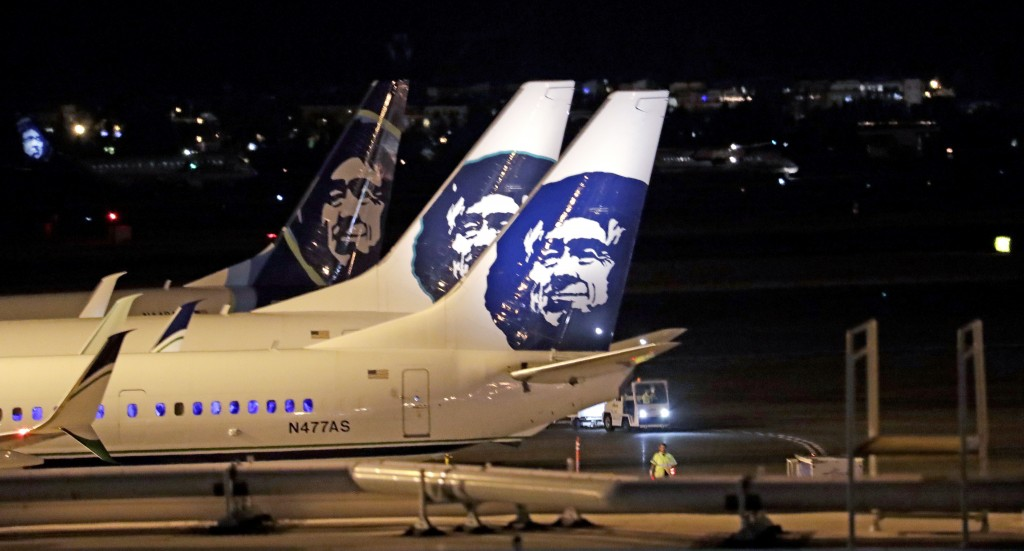 Alaska Airlines planes sit on the tarmac at Sea-Tac International Airport Friday evening, Aug. 10, 2018, in SeaTac, Wash. An airline mechanic stole an...