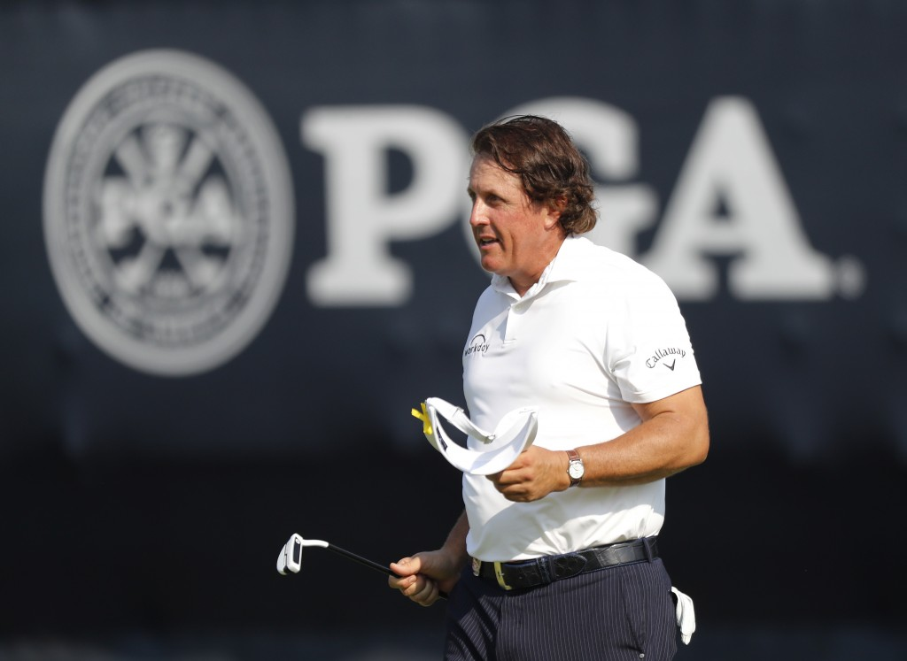 Phil Mickelson walks off the 18th green following the second round of the PGA Championship golf tournament at Bellerive Country Club, Saturday, Aug. 1