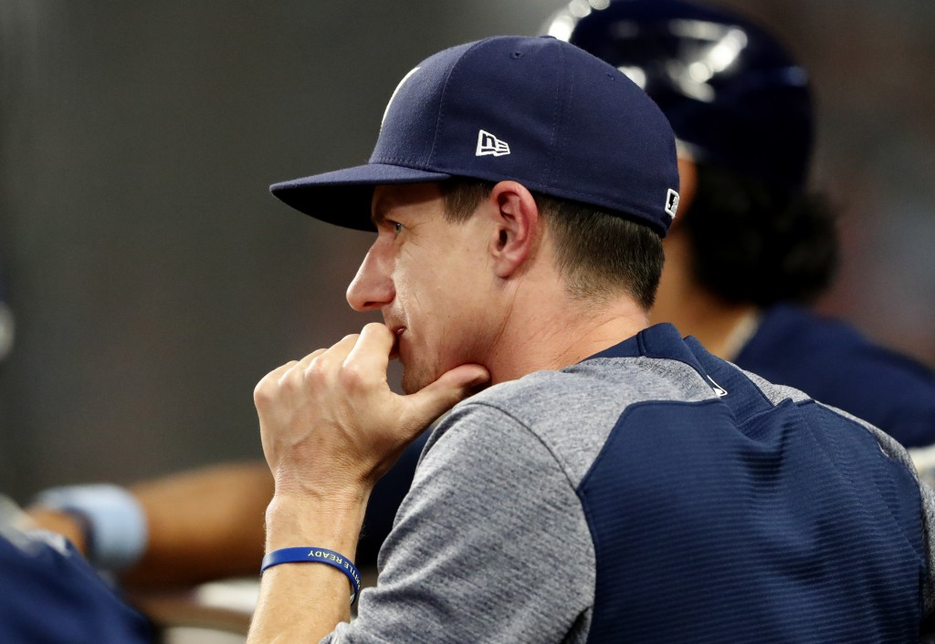 Milwaukee Brewers manager Craig Counsell watches from the dugout during a baseball game against the Atlanta Braves, Friday, Aug. 10, 2018, in Atlanta.