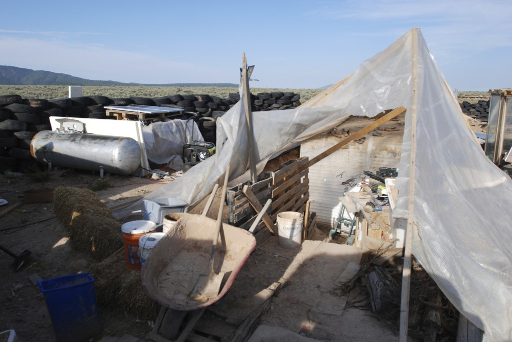 Various items litter a squalid makeshift living compound in Amalia, N.M., on Friday, Aug. 10, 2018, where five adults were arrested on child abuse cha...