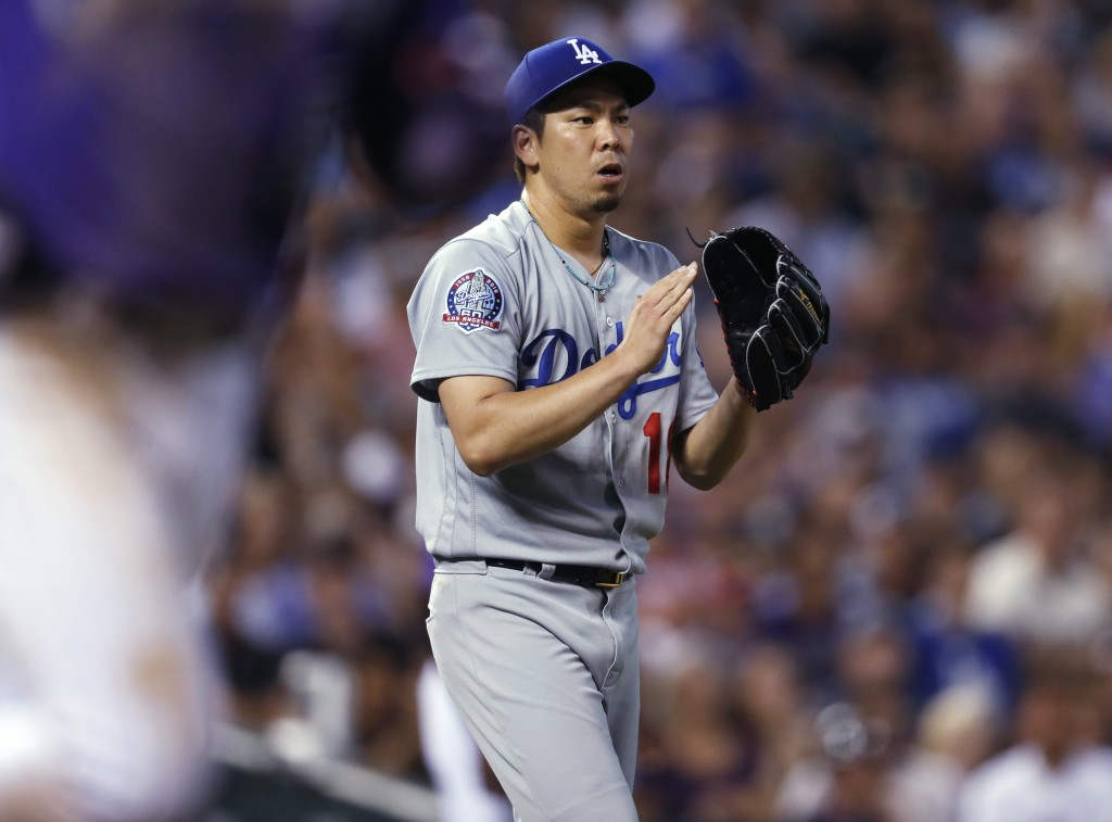 Los Angeles Dodgers starting pitcher Kenta Maeda claps after getting Colorado Rockies' Carlos Gonzalez to ground out to end the fourth inning of a bas