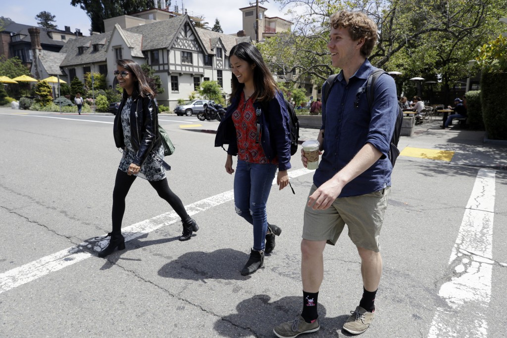 University of California students, from left, Anjali Banerjee, Alice Ma and Tyler Heintz walk near the university's campus Wednesday, June 6, 2018, in
