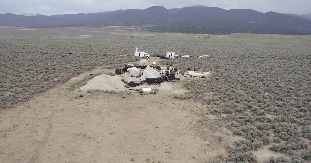 This aerial image shows a remote outpost near Amalia, N.M on Thursday, Aug. 9, 2018.  Three siblings and two other adults have been charged with child