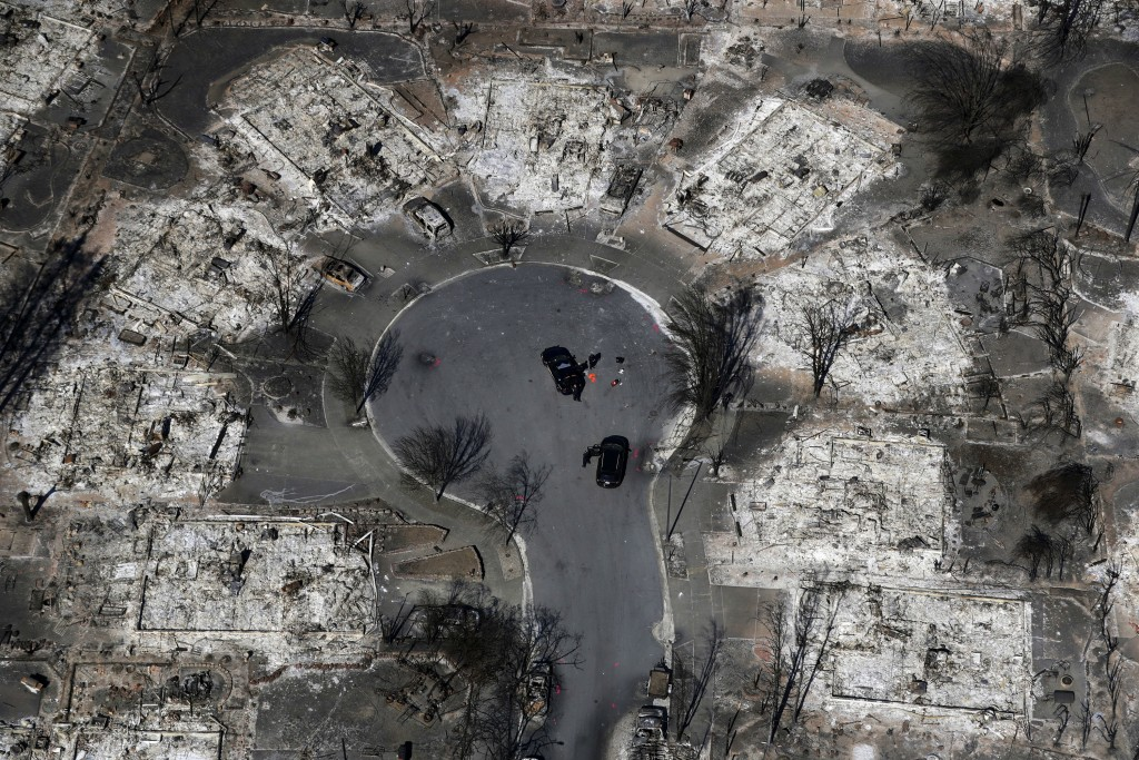 FILE - In this Oct. 14, 2017 file photo, an aerial view shows the devastation of the Coffey Park neighborhood after the Tubbs wildfire swept through S