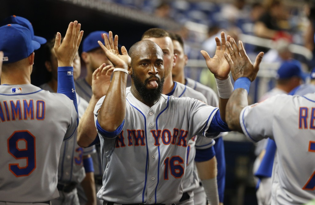 New York Mets' Austin Jackson (16) is congratulated by teammates after he and Todd Frazier scored on a single by Amed Rosario during the sixth inning