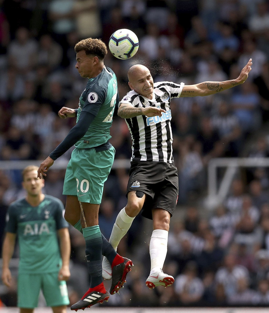 Tottenham Hotspur's Dele Alli, left, and Newcastle United's Jonjo Shelvey contest for a header during their English Premier League soccer match at St