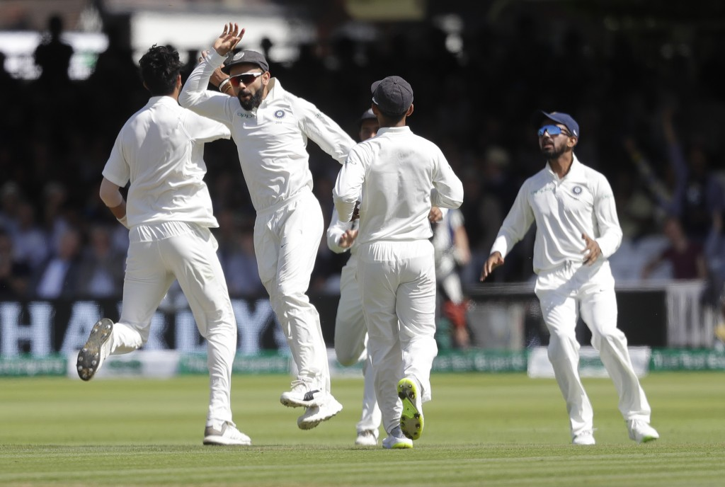 India's captain Virat Kohli celebrates as India's Ishant Sharma, left, takes the wicket of England's Alastair Cook during the third day of the second