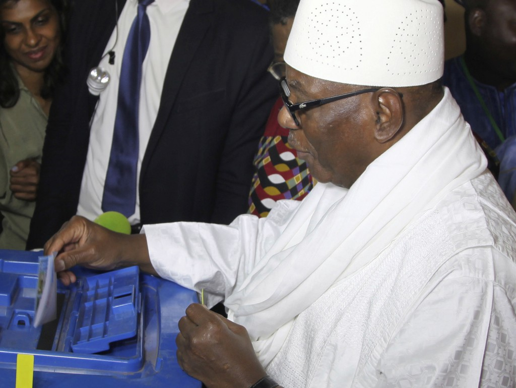 FILE - In this file photo dated Sunday, July 29, 2018, Mali Incumbent President, Ibrahim Boubacar Keita, casts his ballot in Bamako, Mali, during the