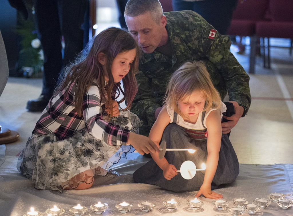 Residents attend a candlelight vigil at St. John the Evangelist Anglican Church, in Fredericton, New Brunswick, Canada, on Friday, Aug. 10, 2018. Two