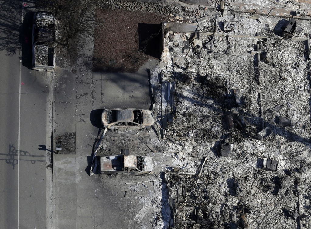 FILE - In this Oct. 14, 2017, file photo, an aerial view shows the devastation of the Coffey Park neighborhood after a wildfire swept through the area