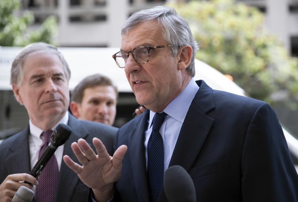 Paul Kamenar, attorney for Andrew Miller, joined by Peter Flaherty, chairman of the National Legal and Policy Center, left, talks to reporters after a