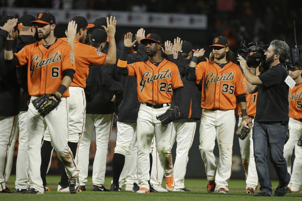 The San Francisco Giants celebrate at the end inning of a baseball game against the Pittsburgh Pirates Friday, Aug. 10, 2018, in San Francisco. San Fr