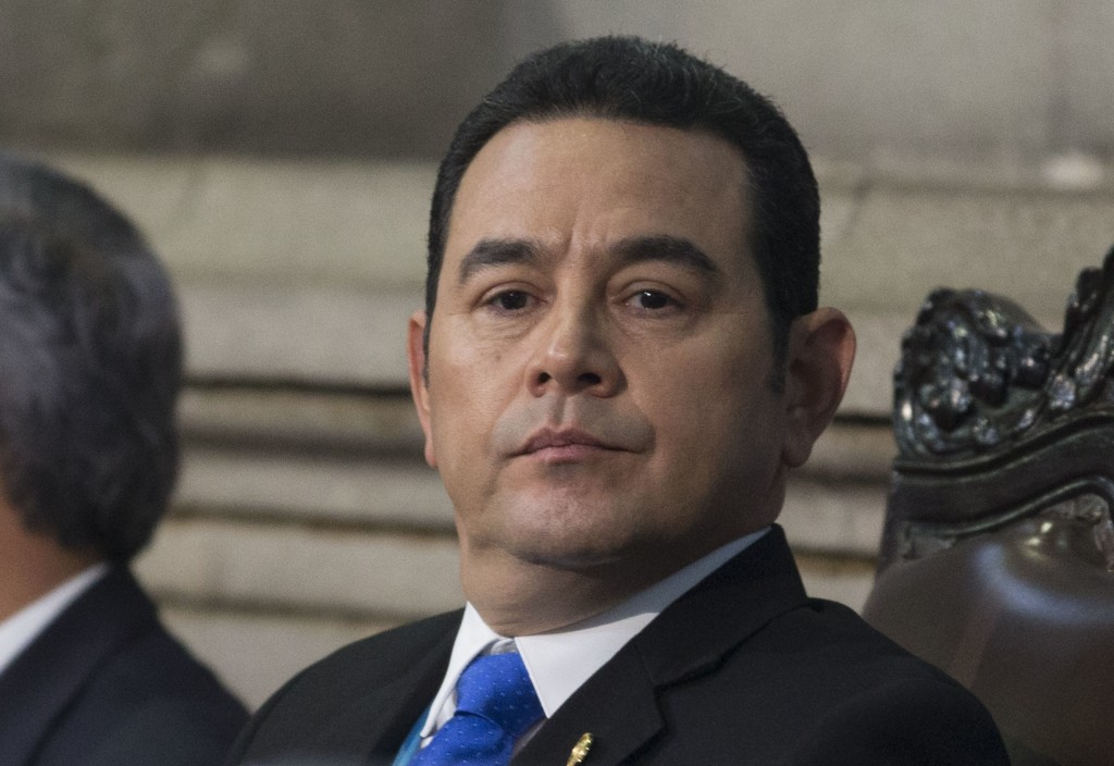 FILE - This Jan. 14, 2018 file photo shows Guatemala's President Jimmy Morales at his second annual State of the Nation, in Guatemala City. The office