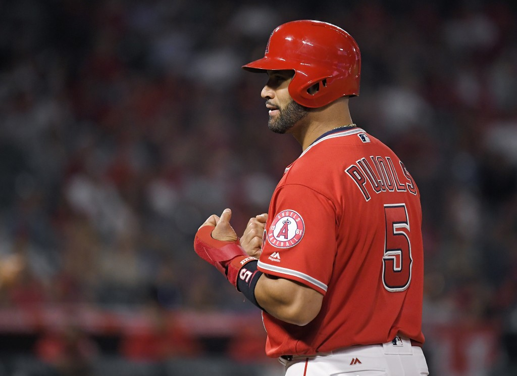 Los Angeles Angels' Albert Pujols gestures after hitting a single during the sixth inning of a baseball game against the Oakland Athletics on Friday,