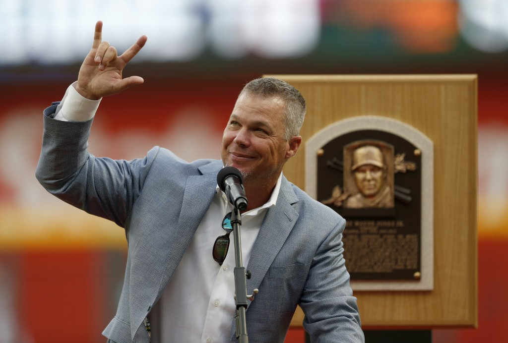Former Atlanta Braves third baseman and Baseball Hall of Fame member Chipper Jones waves to the crowd as he speaks during a ceremony before a baseball