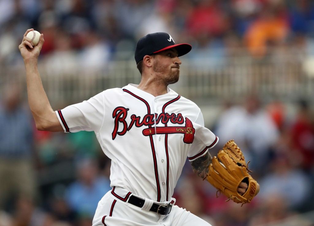 Atlanta Braves starting pitcher Kevin Gausman works in the first inning of a baseball game against the Milwaukee Brewers, Friday, Aug. 10, 2018, in At