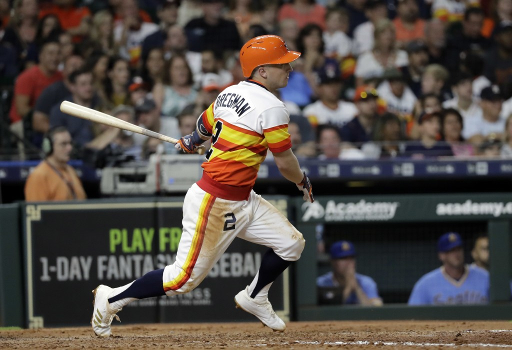 Houston Astros' Alex Bregman heads to first on an RBI double against the Seattle Mariners during the fifth inning of a baseball game Friday, Aug. 10,