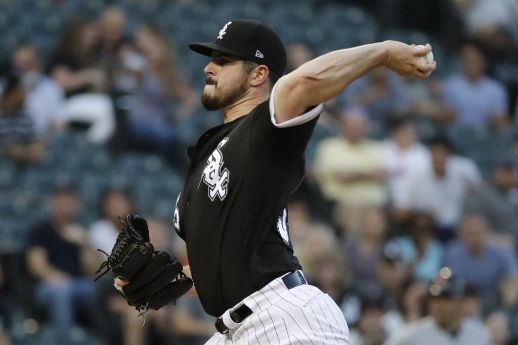 Chicago White Sox starting pitcher Carlos Rodon throws to a Cleveland Indians batter during the first inning of a baseball game Friday, Aug. 10, 2018,