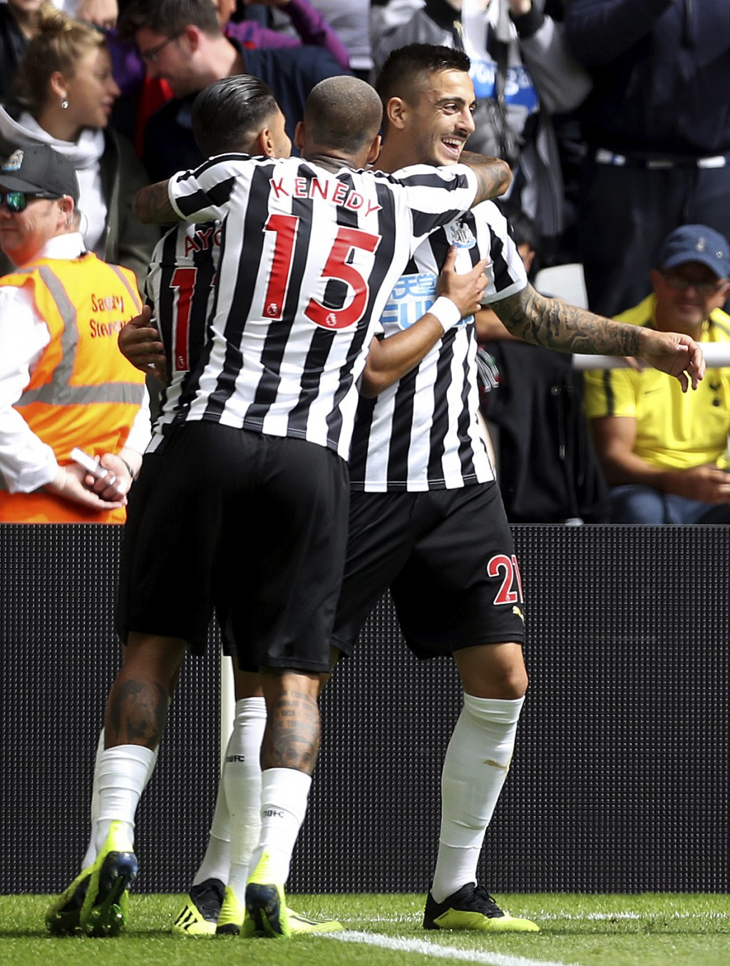Newcastle United's Joselu, right, celebrates scoring his side's first goal of the game against Tottenham during their English Premier League soccer ma